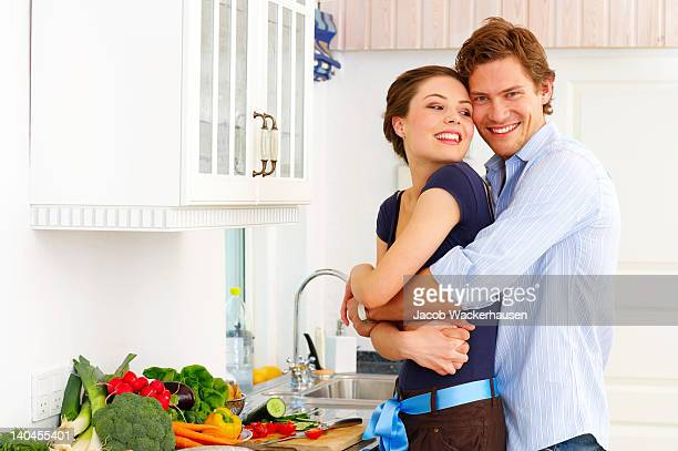 happy couple in their kitchen - couples making passionate love stock pictures, royalty-free photos & images