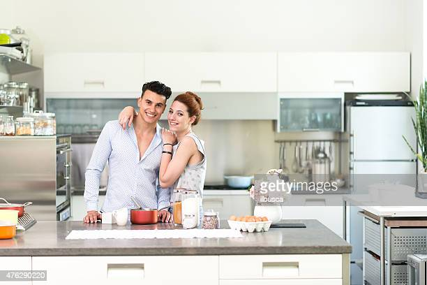 Happy couple in their new kitchen