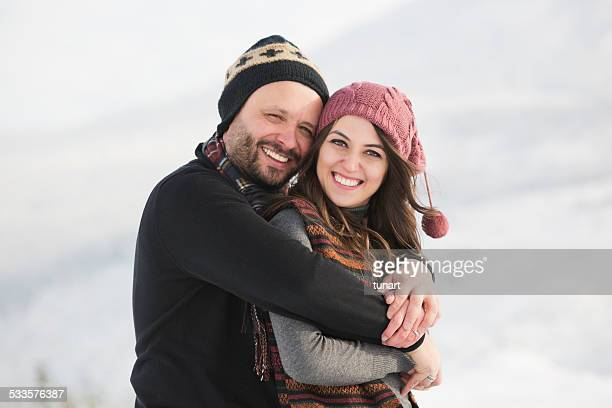 happy couple in winter - mid adult couple stock pictures, royalty-free photos & images