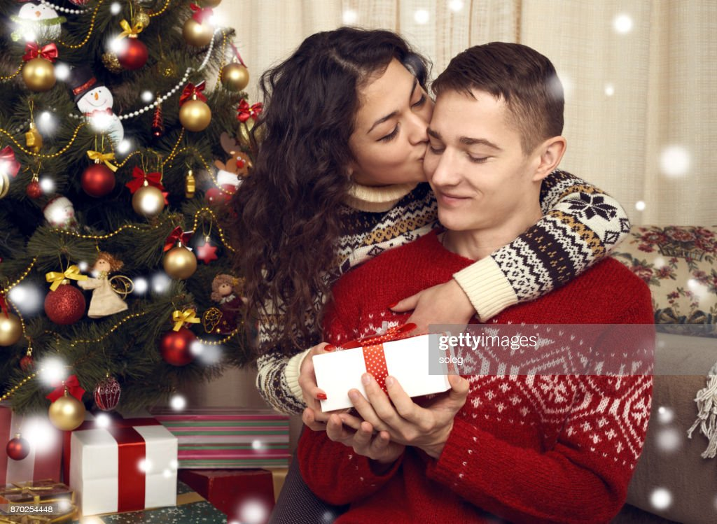 Happy Couple Kiss In Christmas Decoration At Home New Year Eve ...