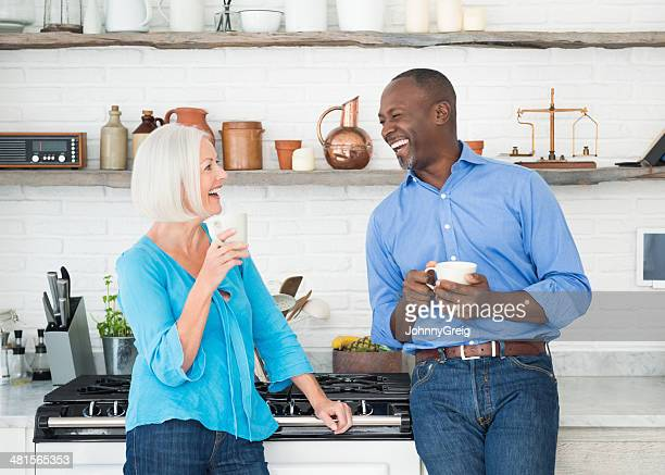 happy couple laughing - 50 59 years stock pictures, royalty-free photos & images