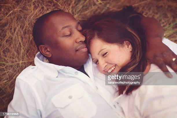 Happy couple laying down in grass
