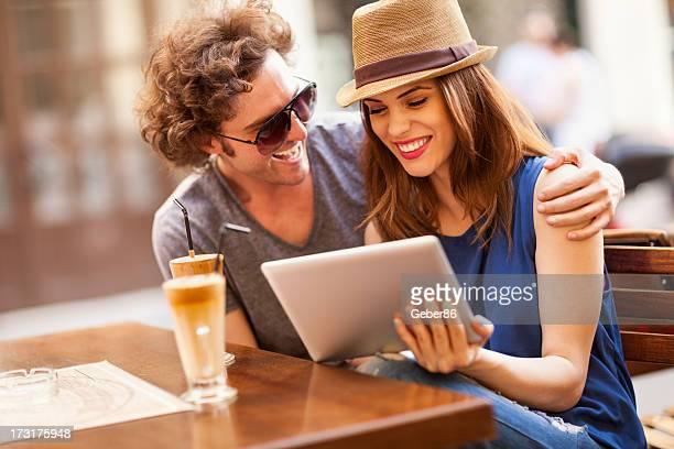 Happy couple  looking at digital tablet
