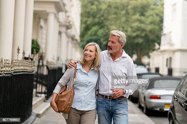 Happy couple looking at houses