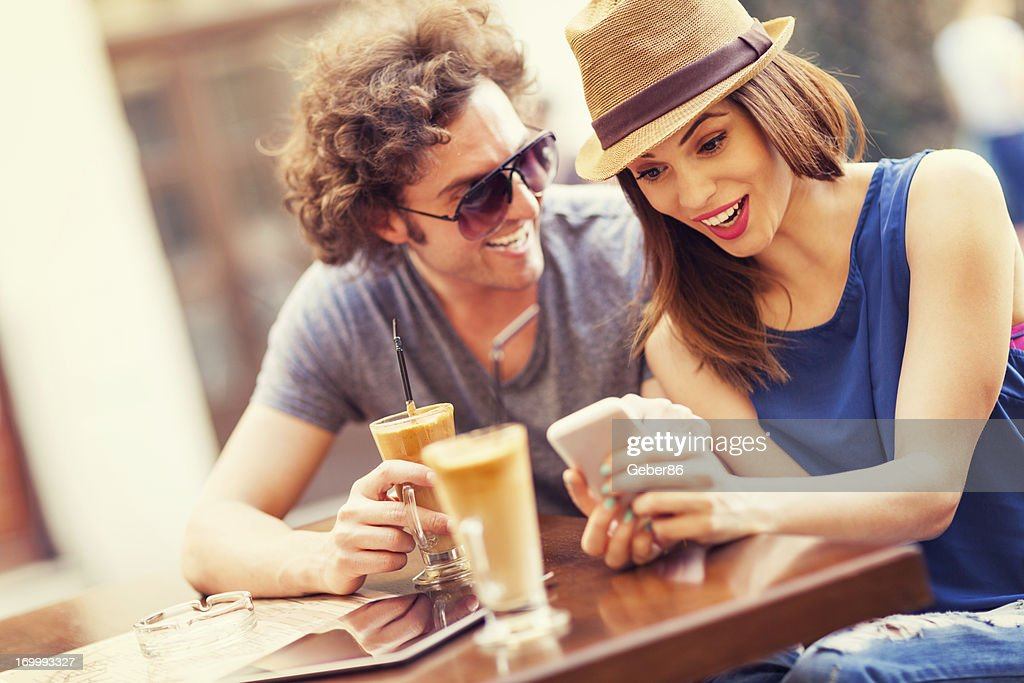 Happy couple  looking at mobile phone : Stock Photo