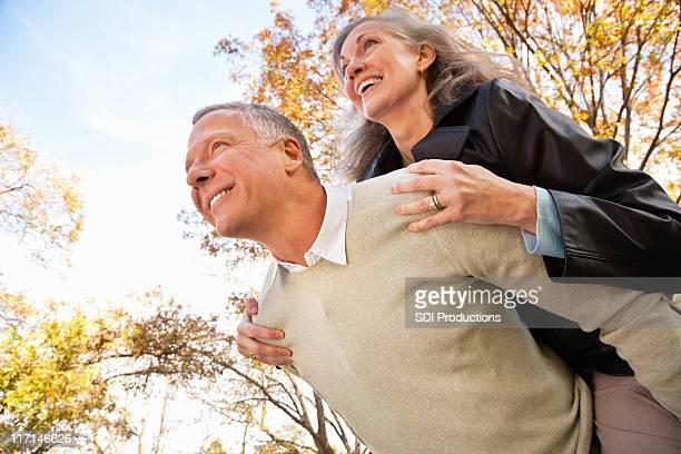 Happy Couple Looking Forward Together With Beautiful Trees in Background