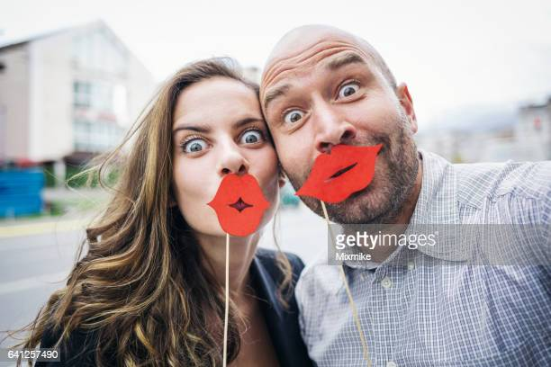 happy couple making jokes - big lips stock photos and pictures