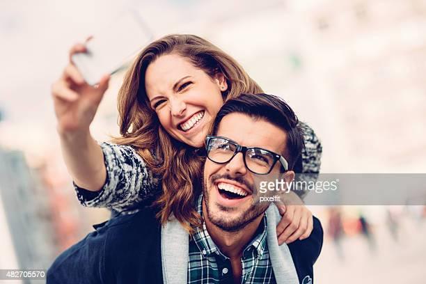 Happy couple making selfie outdoors