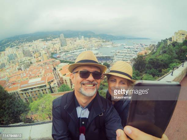 happy couple making selfie - monte carlo stock pictures, royalty-free photos & images