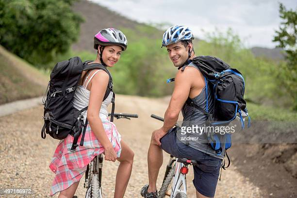 Happy couple mountain biking