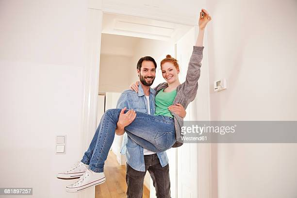 Happy couple moving into their new apartment