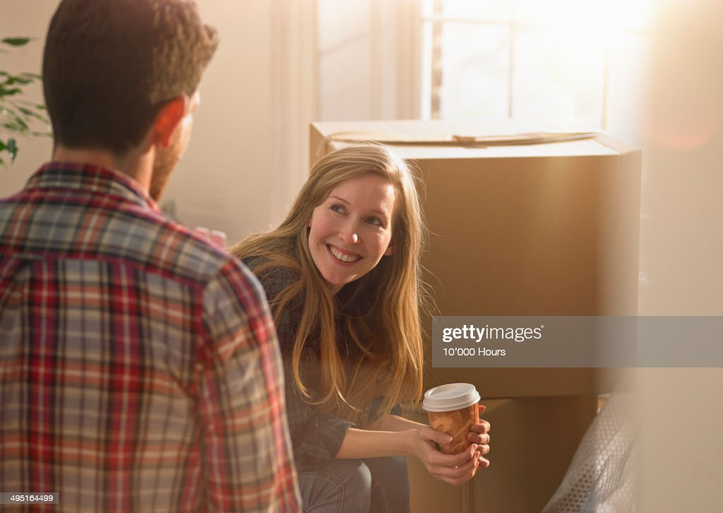 Happy couple moving into their new home : Stock Photo