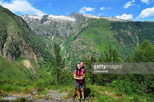 happy couple of hikers hugging in the mountain - midi pyrénées stock photos and pictures