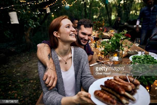 happy couple on a barbecue garden party - image stock-fotos und bilder