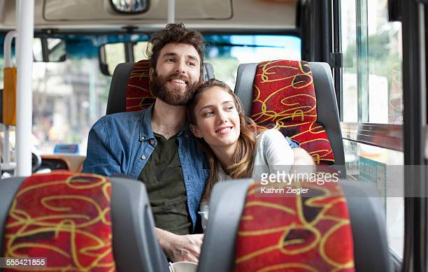 happy couple on a bus