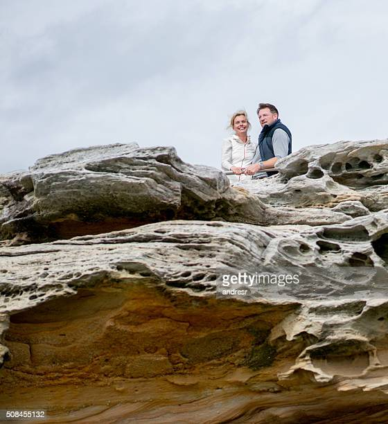 Happy couple on a cliff