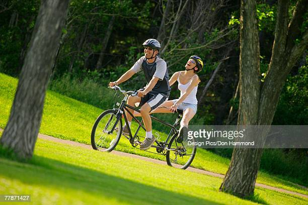 Happy couple on a tandem bike
