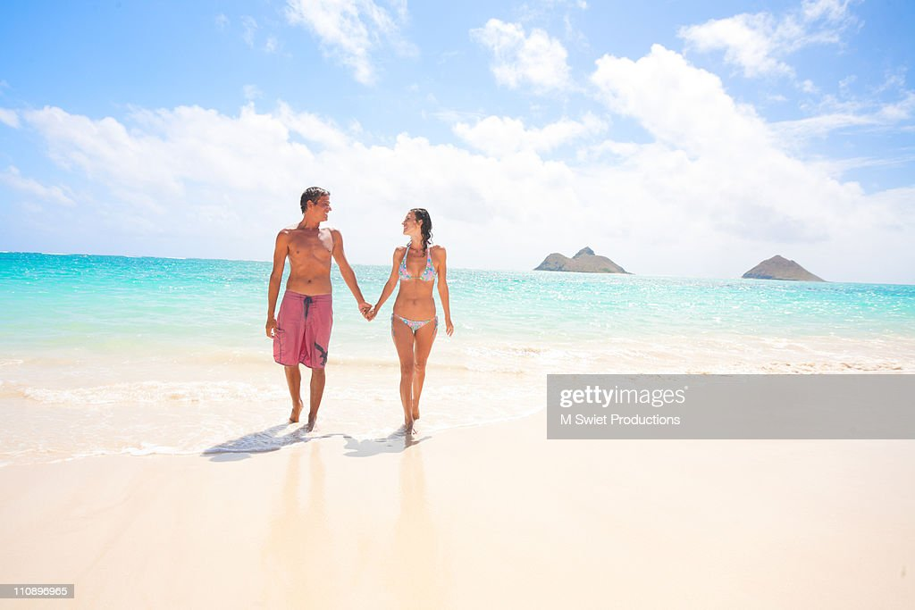 Happy couple on beach, Hawaii : Stock Photo
