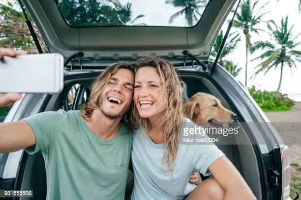 Happy couple on road trip