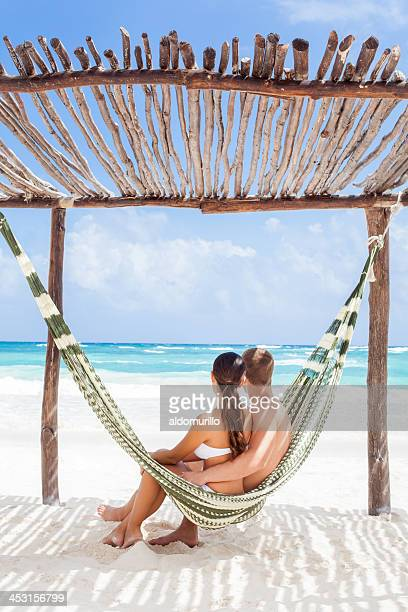 happy couple on vacation watching the ocean - tulum mexico stock photos and pictures