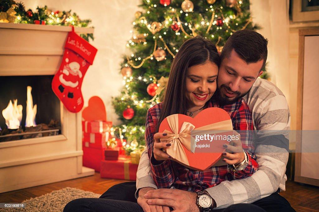 happy couple opening christmas presents stock photo