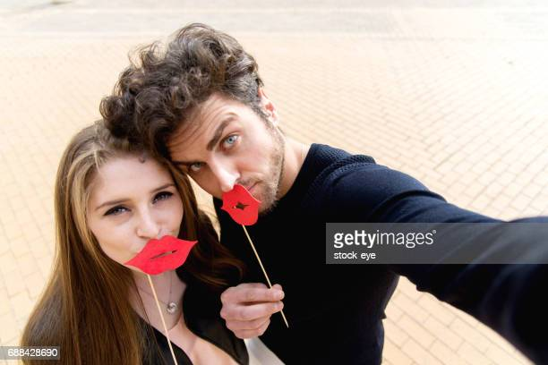 happy couple - big lips stock photos and pictures