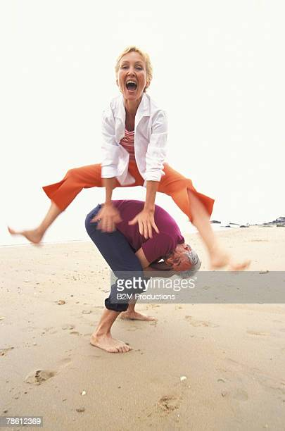 Happy couple playing at beach