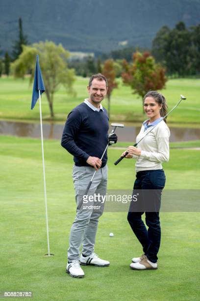 Happy couple playing golf together