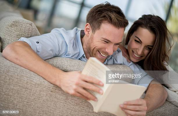 Happy couple reading a book