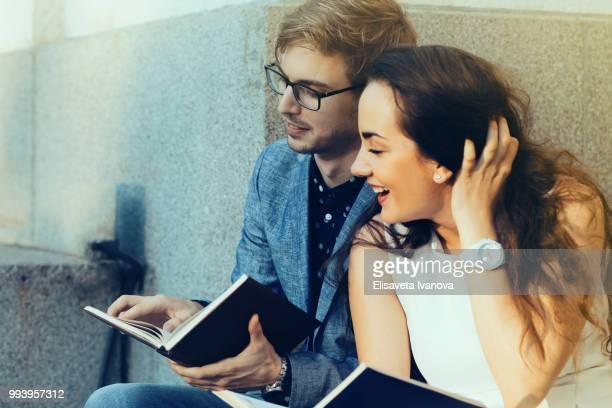 Happy couple reading books