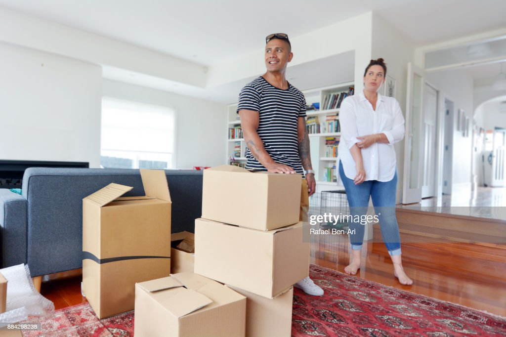 Happy couple relax in their new home : Stock Photo