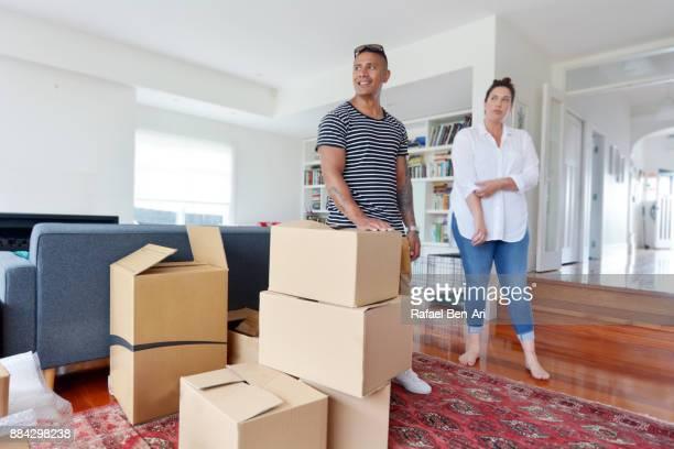 happy couple relax in their new home - rafael ben ari stockfoto's en -beelden
