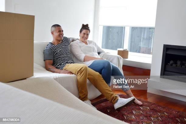 happy couple relax in their new home - rafael ben ari bildbanksfoton och bilder