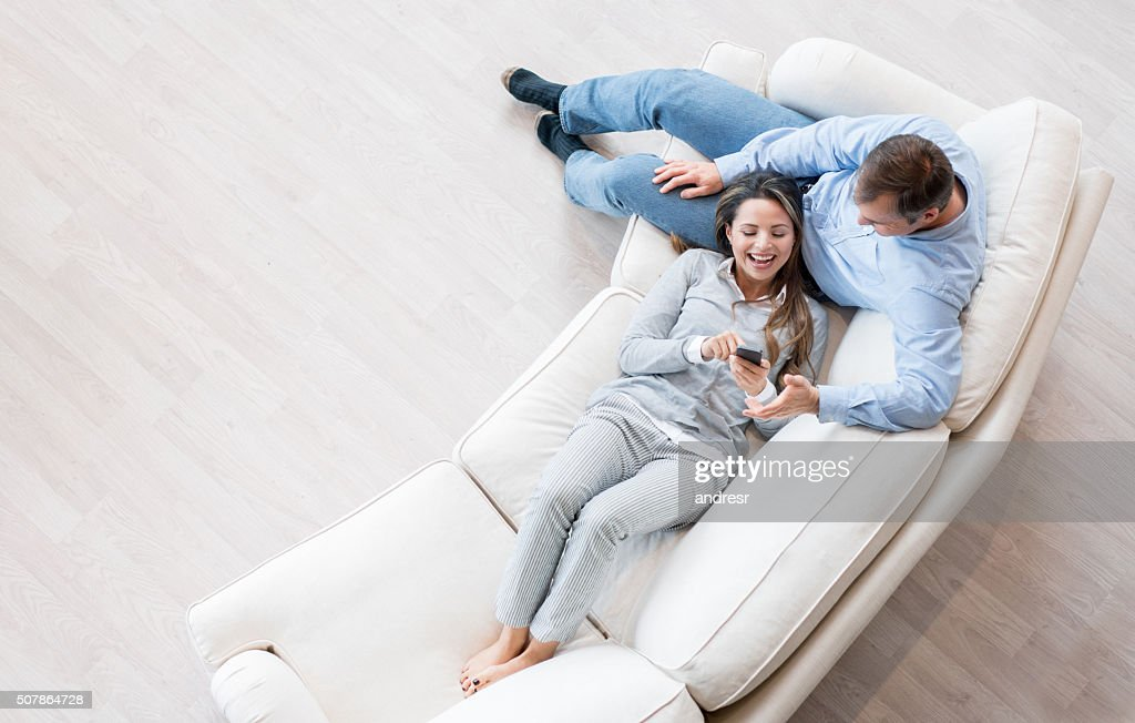 Happy couple relaxing at home : Stock Photo