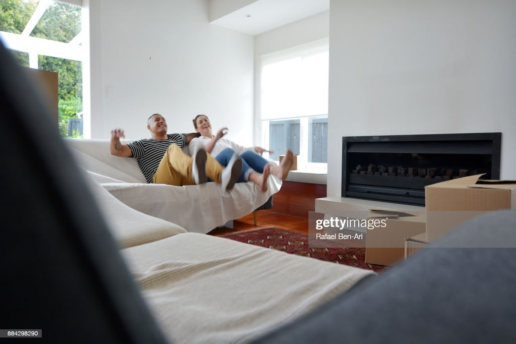 Happy couple relaxing in their new home : Foto de stock