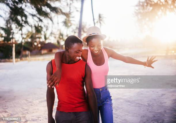 happy couple riding bicycle - east africa stock pictures, royalty-free photos & images