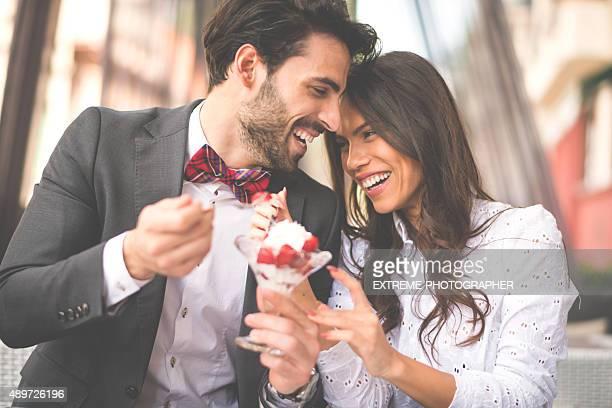 Happy couple sharing fruit salad