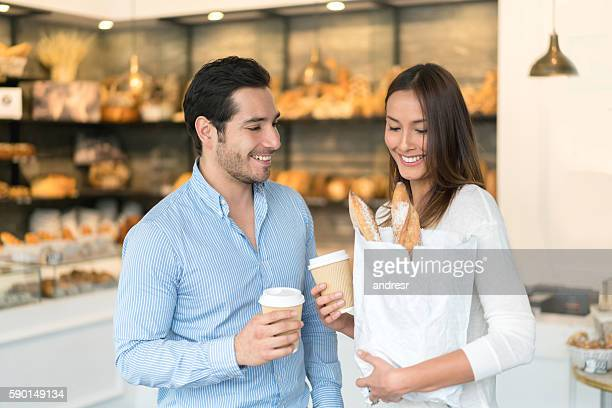 Happy couple shopping at the bakery