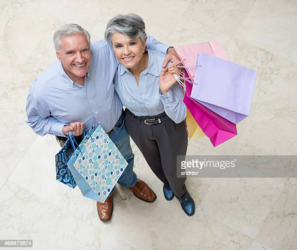 Happy couple shopping at the mall