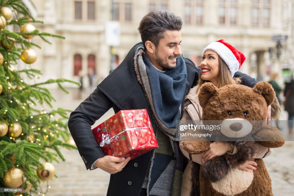 Happy couple shopping for christmas : Stock Photo