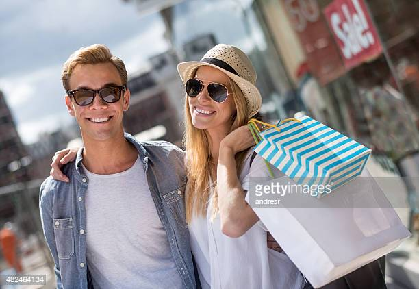 Happy couple shopping for the summer