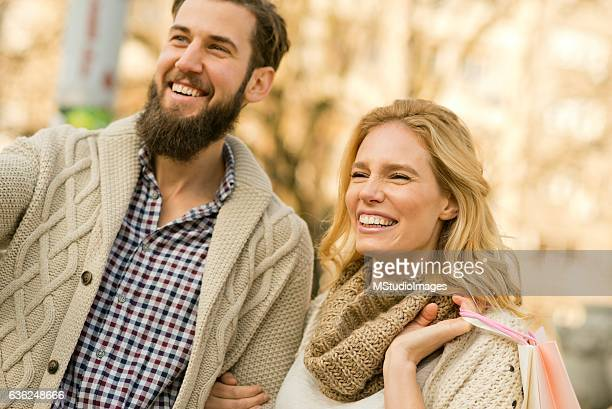 Happy couple shopping.