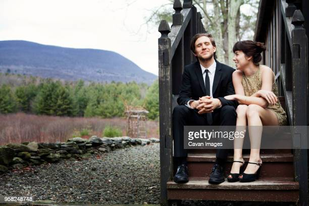 Happy couple sitting on steps