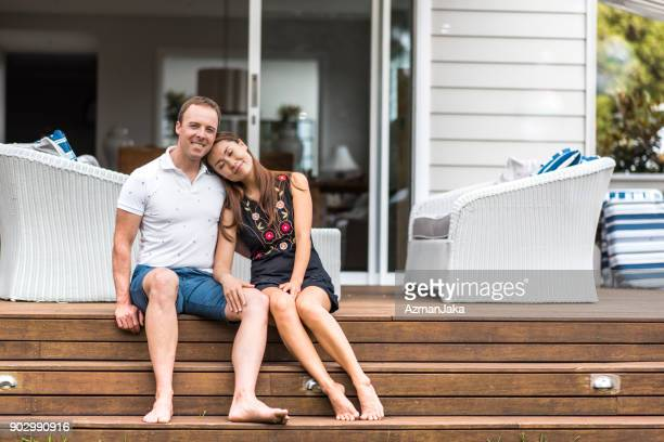 Happy couple sitting on the porch