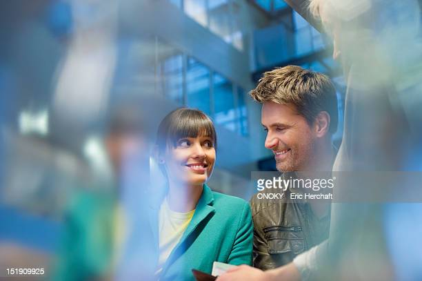 Happy couple standing at a checkout counter