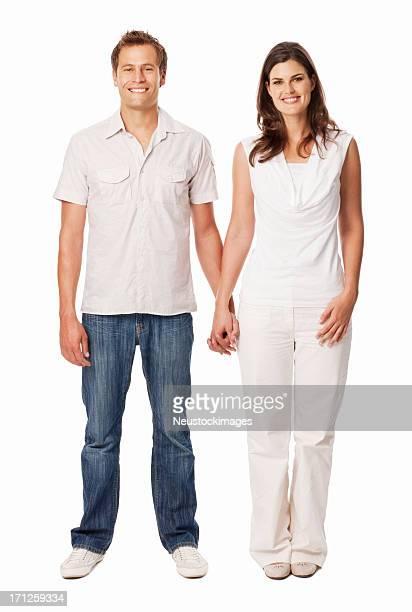 Pie feliz pareja sosteniendo las manos juntas aisladas