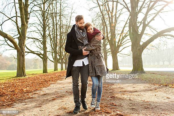 Happy couple strolling in autumn