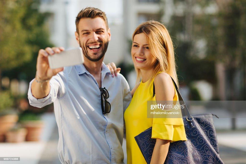 Happy couple taking a selfie : Stock Photo