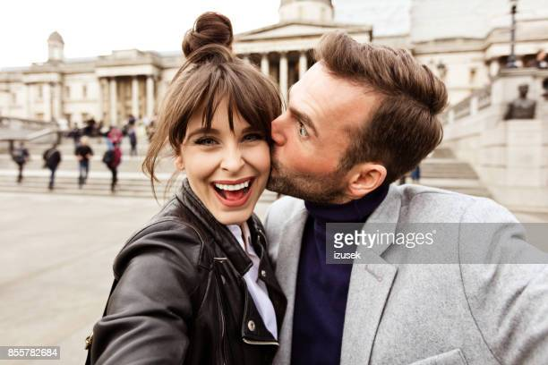 happy couple taking selfie in front of national gallery in london - national gallery london stock pictures, royalty-free photos & images
