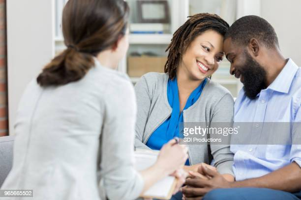 Happy couple talk with therapist